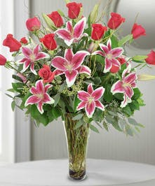 a dozen  roses  with lilies