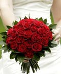 Red bouquet with coordinating accessories
